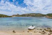 Dinghy at bautiful island bay beach — Stock Photo