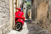 Classic red scooter — Stock Photo