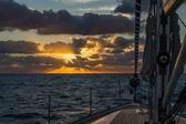 Sailing boat at sunrise in Atlantic ocean — Stock Photo