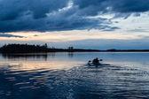 Sunset kayaking at lake — Stock Photo