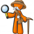 Orange Man Explorer with Magnifying Glass - Stock Photo