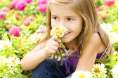 Cheerful child with flowers — Stock Photo