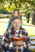 Grandfather and grandson reading book — Stock Photo