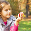 Child eating fresh apple — Stock Photo #16637383