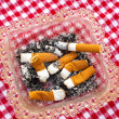 Stock Photo: Cigarette and ashtray