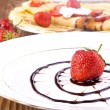 Stock Photo: Pancakes with fresh strawberries and chocolate