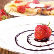 Pancakes with fresh strawberries and chocolate — Stock Photo