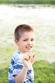 Pleasantly surprised little boy — Stockfoto