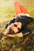 Beautiful girl resting on the grass — Stock Photo