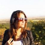 Young woman enjoying the music — Stock Photo #31237967