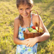 little girl with basket of fresh fruit — Stock Photo
