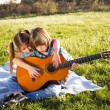 Children play guitar — Stock Photo