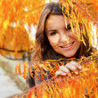 Beautiful girl in autumn leaves — Stock Photo
