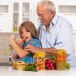 Stock Photo: Grandson and grandfather eat healthy foods