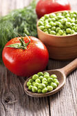 Green peas and fresh vegetables — Stock Photo