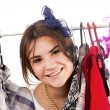 Happy girl in a shop buying clothes — Stock Photo #49089783