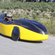 Man in Recumbent Velomobile cycling on road — Stock Photo
