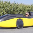 Stock Photo: Full Profile of Cyclist in Recumbent Bicycle Car