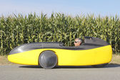 Full Profile of Man in Recumbent Velomobile — Stock Photo