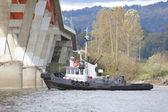 Tug Boat Navigates Under Bridge — Stock Photo