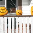 Three Halloween Pumpkins on Porch — Stock Photo