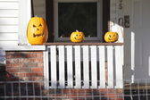 Three Evil Halloween Pumpkins on Porch — Stock Photo