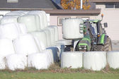 Winter Feed Bales and Tractor — Foto Stock