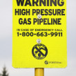 Stock Photo: High Pressure Gas Pipeline Warning