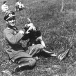 German Nazi lieutenant and German Shepherd — Stock Photo