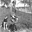 German Nazi lieutenant with German Shepard — Stock Photo