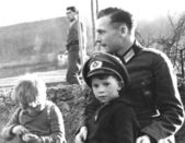 Children with German Nazi Soldier — Stock Photo