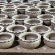Large group of clay pots spread — Stock Photo