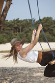 Swinging lady in nature — Stock Photo