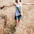 A girl in a wheat field — Stock Photo #27246347