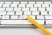 Keyboard and pencil — Stock Photo