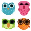 Four cute little cartoony owls — Stock Vector