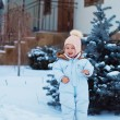 Little girl near the fir tree in winter — Foto de Stock