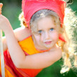 Portrait of little girl outdoors in summer — Stock Photo