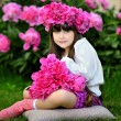 Portrait of little girl outdoors with peony — Stock Photo #14761973