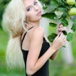 Portrait of a beautiful blonde girl outdoors in summer — Stock Photo #14781293