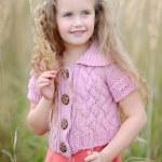 Portrait of little girl outdoors in autumn — Stock Photo #14781343