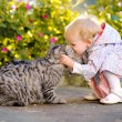 Portrait of little girl with cat — Stock Photo #14824131