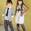 Portrait of stylish little boy and girl outdoors — Stock Photo #14868605