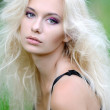 Portrait of a beautiful blonde girl outdoors in summer — Stock Photo #14869479