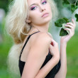 Foto Stock: Portrait of beautiful blonde girl outdoors in summer
