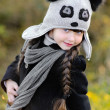 Portrait of little girl outdoors in autumn — Stock Photo