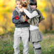 Portrait of little boy and girl outdoors in autumn — Stock Photo #14869565