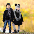 Portrait of little boy and girl outdoors in autumn — Stok fotoğraf