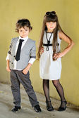Portrait of stylish little boy and girl outdoors — Stock Photo