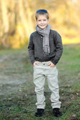 Portrait of little boy outdoors in autumn — Stock Photo